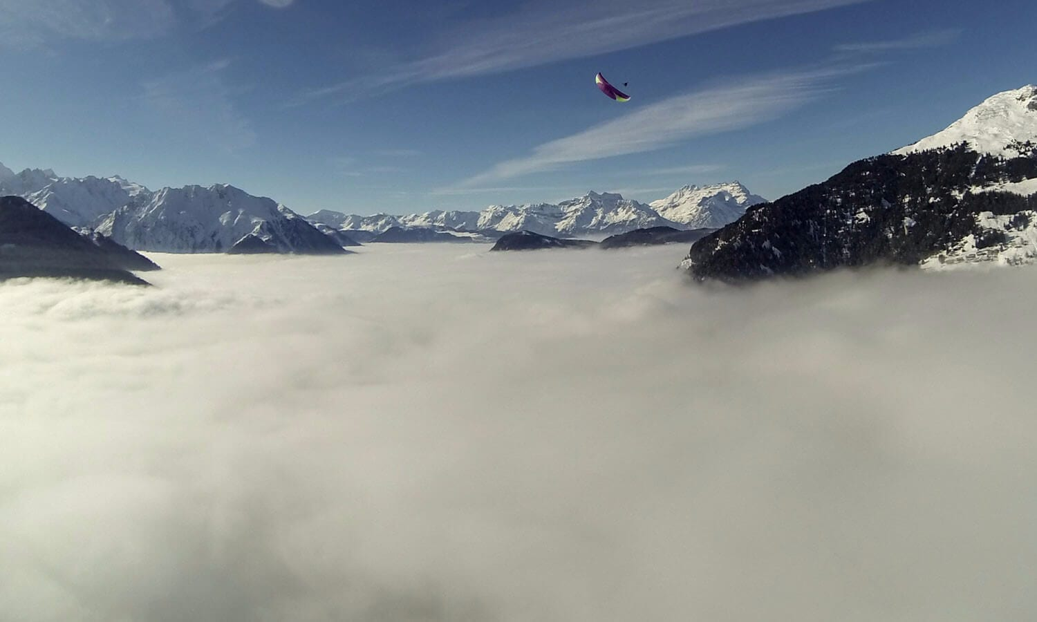 Paragliding above the clouds Switzerland
